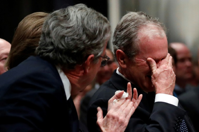 Former president George W. Bush weeps after delivering his eulogy at the state funeral for his father George H.W. Bush at Washington National Cathedral. Photo by POOL/AFP/Alex Brandon