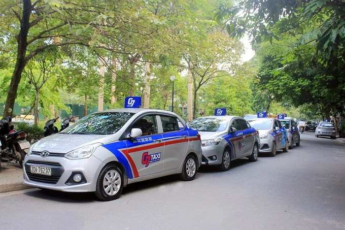 New Hanoi taxi merger to fight Grab on the streets