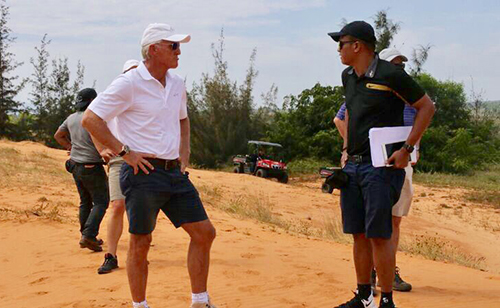 Greg Norman (L) in a working trip to Phan Thiet