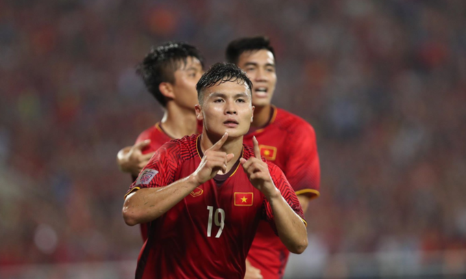 Nguyen Quang Hai celebrates his goal in Vietnam - Philippines match. Photo by VnExpress/Duc Dong.