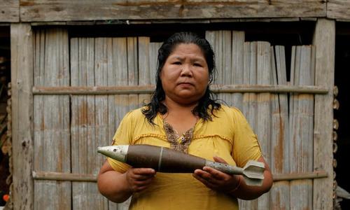 Turning bombs into bracelets, as Laos villagers wait for safe land