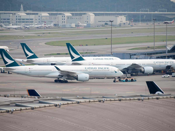 Cathay Pacific announced in March it would introduce a trouser option for female attendants, ending a 70-year skirt rule. Photo by AFP/Anthony Wallace Wallace