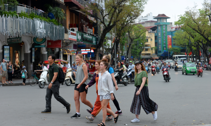 Foreign tourists walk around the Hanois Old Quarter. Photo by Shutterstocks/Minhhue