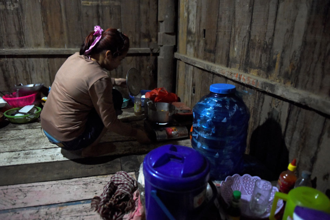 Nary, a Cambodian victim of forced marriage to a Chinese man, cooking at home in Phnom Penh.