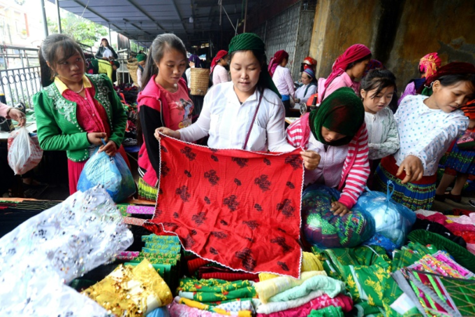 Traffickers target girls at the busy weekend market, where they roam around in packs dressed in their Sunday best