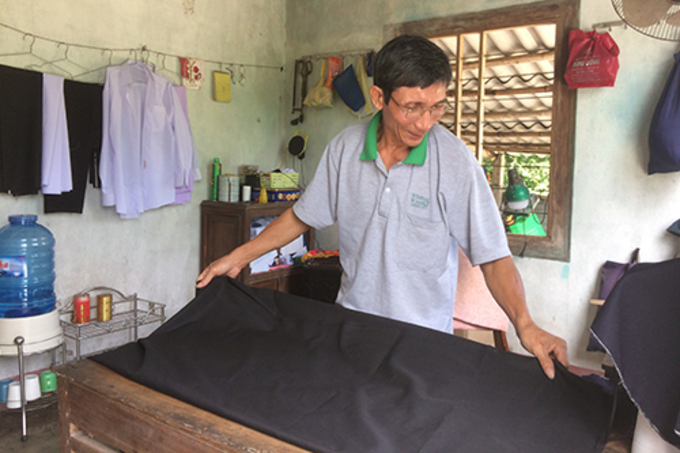 After the explosion, Nguyen Thanh Chuong lost his leg. He works as a tailor. Photo by VnExpress/Hoang Tao