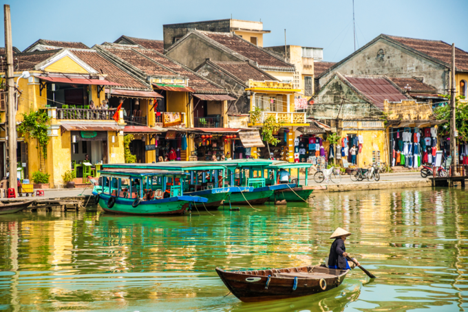 View of busy river in ancient city Hoi An. Photo by Romas/Shutterstock.