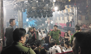 Saigon police raid bar, find it is a drug den