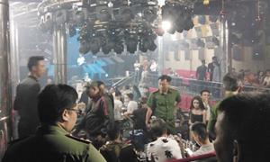 Saigon police raid bar, find it is a drug den