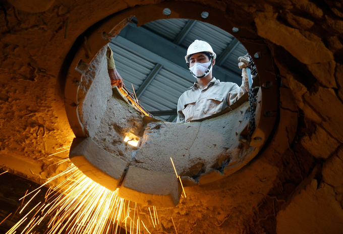 An employee works in a cement factory in the northern province of Hai Duong, Vietnam. Photo by Shutterstock/Thi