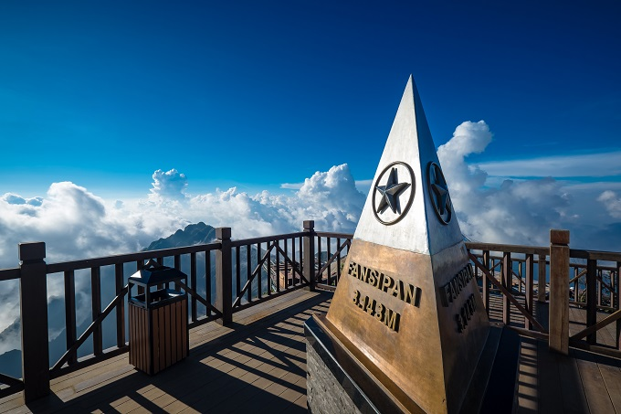 The monument at the summit of Fansipan, the highest peak in Vietnam. Photo by Shutterstock/Ekkalak Ngamjarasvanji