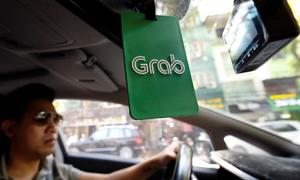 Vietnam court orders Grab to pay Vinasun $208,000