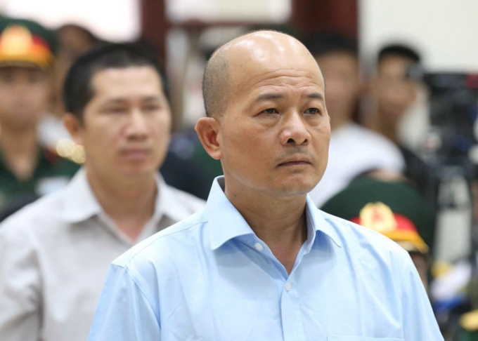 Former colonel Dinh Ngoc He, listens during the verdict session of his trial at a military court in Hanoi, Vietnam July 31, 2018. Photo by Vietnam News Agency.