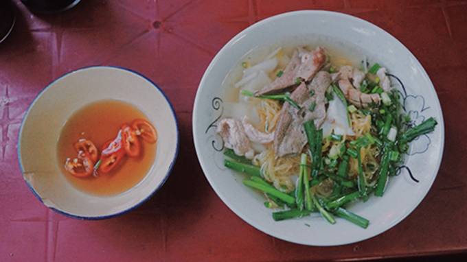 Each of the servings include a bowl of noodle and a bowl of fish sauce. Photo by VnExpress/Di Vy