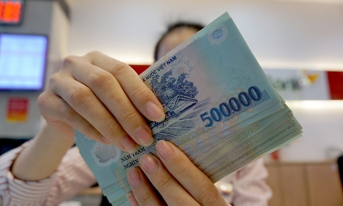Banks report solid profits, employees hopeful of high bonuses