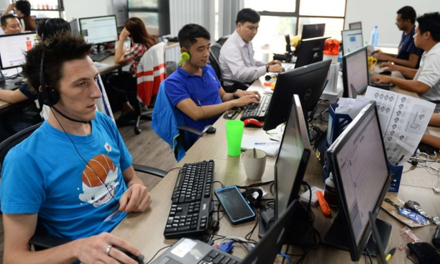 Staff at the French IT company Linkbynet in Ho Chi Minh City. Photo by AFP
