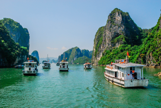 Tourist boats sail on Ha Long Bay in the northern province of Quang Ninh. Photo by Shutterstocks/andien