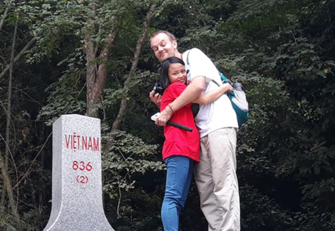 The couple at the 836 milestone in Ban Gioc Waterfall (Cao Bang, Northern Vietnam) in a recent trip. Photo courtesy of the couple.