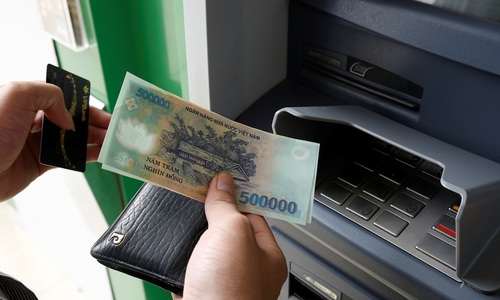 Businesses have long wait to cash in on cashless Vietnam