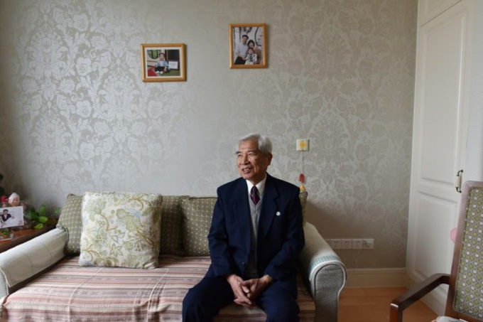 Esperanto language expert Zhu Mingyi poses in his apartment at the Yanyuan community for senior citizens, on the outskirts of Beijing on December 5, 2018. Photo by AFP/Greg Baker