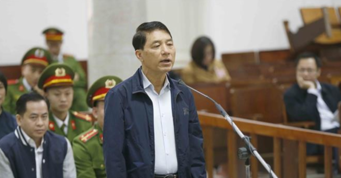 Tran Viet Tan faces the court in Hanoi on Monday. Photo by Vietnam News Agency