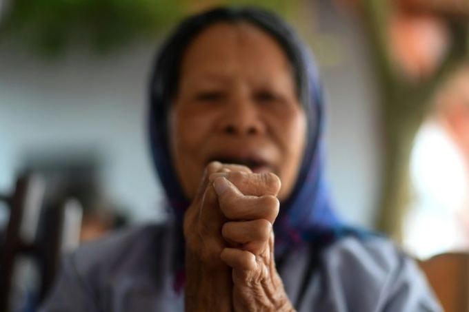 A leprosy survivor offers prayers on the 15th day of lunar month at a pagoda in Van Mon Leprosy hospice compound in Thai Binh Province on January 20, 2019. Photo by AFP/Manan Vatsyayana