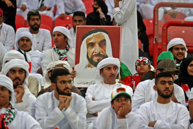 An Emirati supporter carries a portrait of Zayed bin Sultan Al Nahyan, the late founder and president of the UAE, ahead of the 2019 AFC Asian Cup semi-final football match between Qatar and UAE in Abu Dhabi on January 29, 2019. Photo by AFP/Karim Sahib