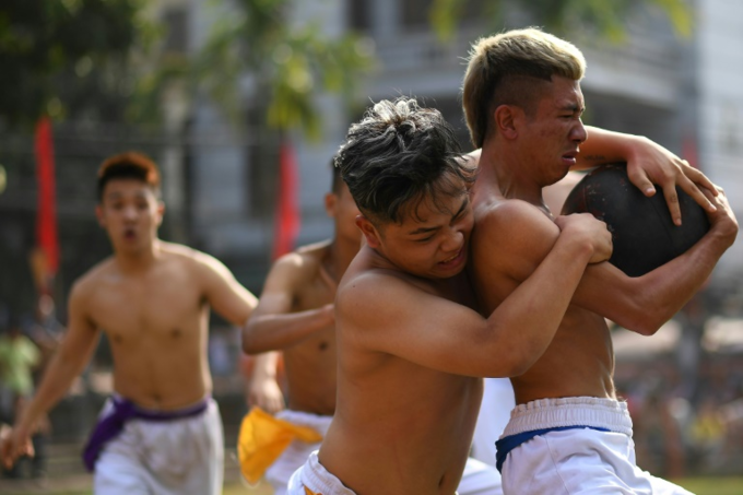 Vat Cau is a centuries-old sport which began as a training exercise for soldiers and contains elements of wrestling and rugby. Photo by AFP/Manan Vatsyayana