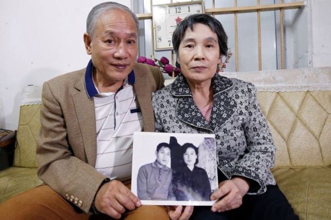 The couple hold their first photo together taken in Spring 1971. Photo by Reuters/Kham
