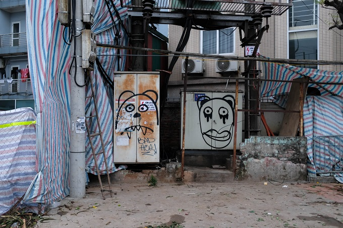 The electric boxes also have painted images on them.
