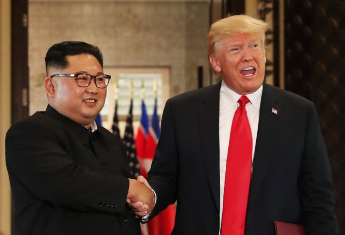 U.S. President Donald Trump and North Koreas leader Kim Jong Un shake hands after signing documents during a summit at the Capella Hotel on the resort island of Sentosa, Singapore June 12, 2018. Photo by Reuters/Jonathan Ernst