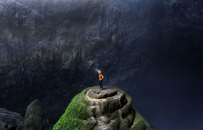 A tourist explores inside the worlds largest cave. Photo by Urs Zihlmann