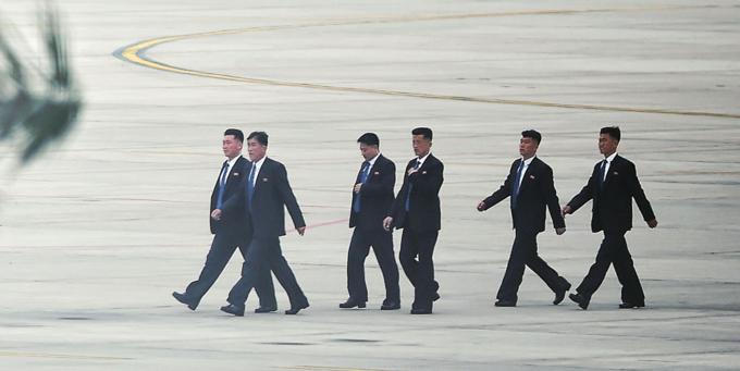 North Korean security agents walk towards the VIP A terminal at Noi Bai Airport in Hanoi. Photo by VnExpress/Ba Do