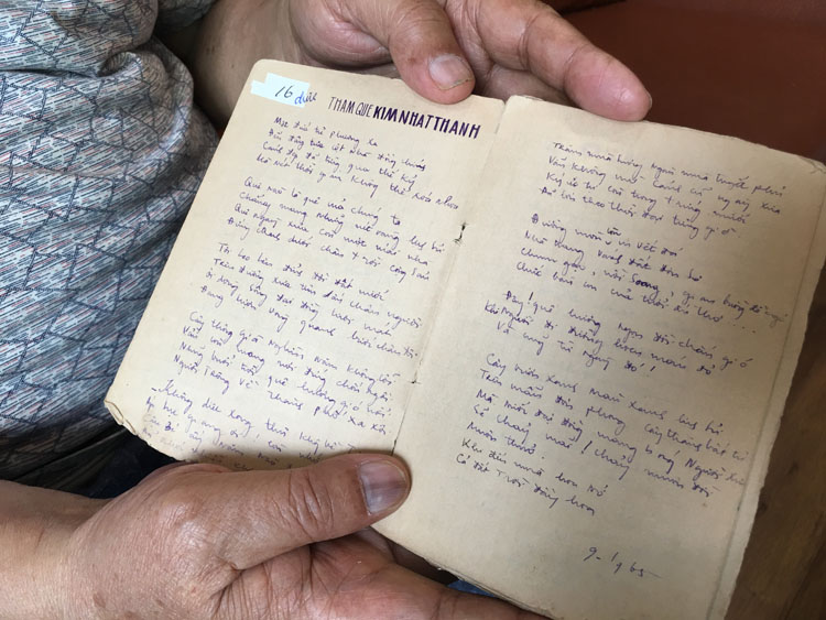 Nguyen Quang Thuyet shows a poem he wrote Visiting the homeland of Kim Il-sung in his handwritten poem notebook in North Korea. Photo by Hanh Pham.