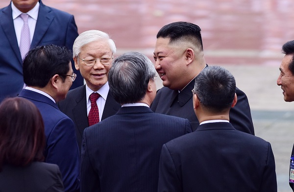 President Nguyen Phu Trong introduces Chairman Kim Jong-un with Vietnamese officials. Photo by Giang Huy