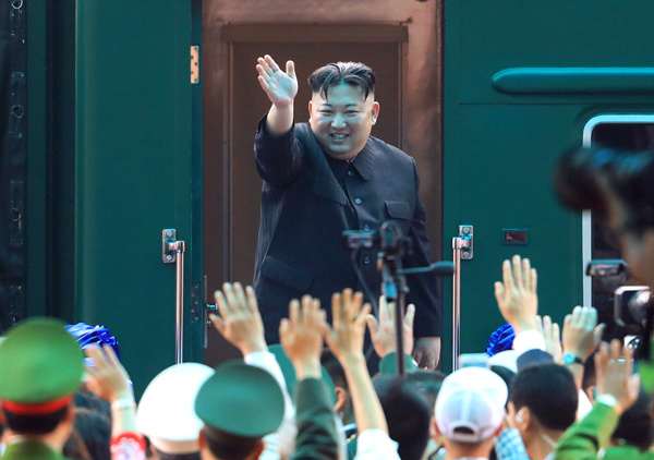 Kim Jong-un waves goodbye, before stepping into his train in Dong Dang station in northern Vietnam, to travel back to Pyongyang, March 2, 2019. Photo by Huu Khoa