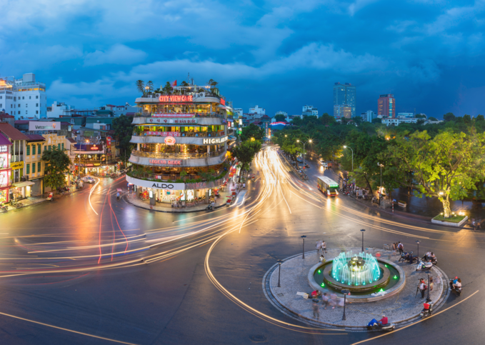 Aerial view of Hanoi cityscape at twilight at intersection locating next to Hoan Kiem lake, center of Hanoi. Photo by Vietnam Stock Images/Shutterstock.