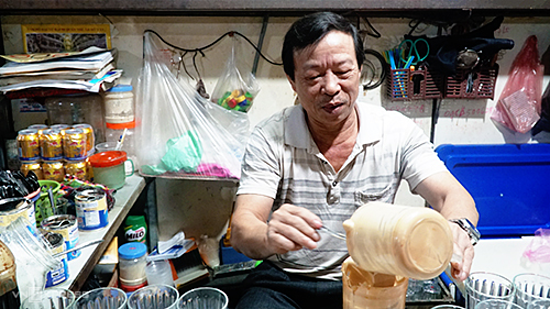 Long at his café in Vinh Market. Photo by VnExpress/Phong Vinh