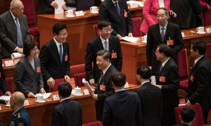 China approves foreign investment law, possible US olive branch