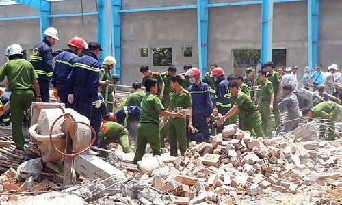 Six dead in Vietnam wall collapse, search on for missing workers