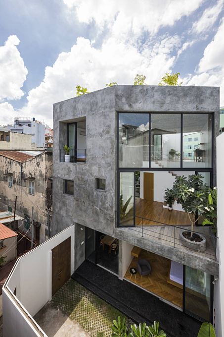 Saigon house cuts corners to fit into a tiny alley - 1