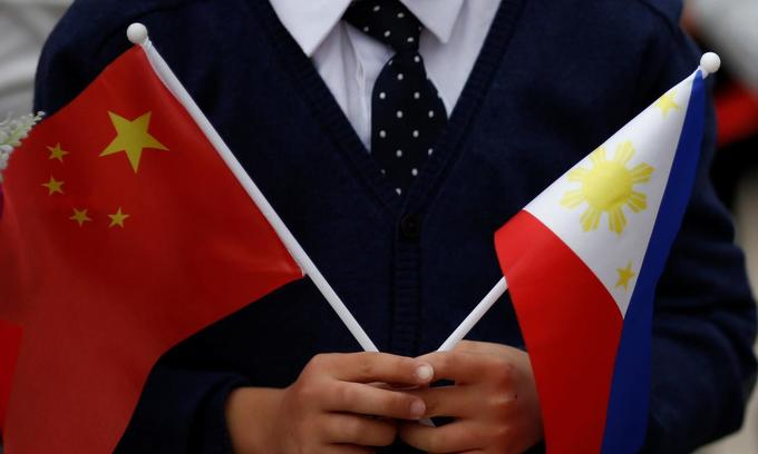 Philippines protests over Chinese vessels in disputed waters