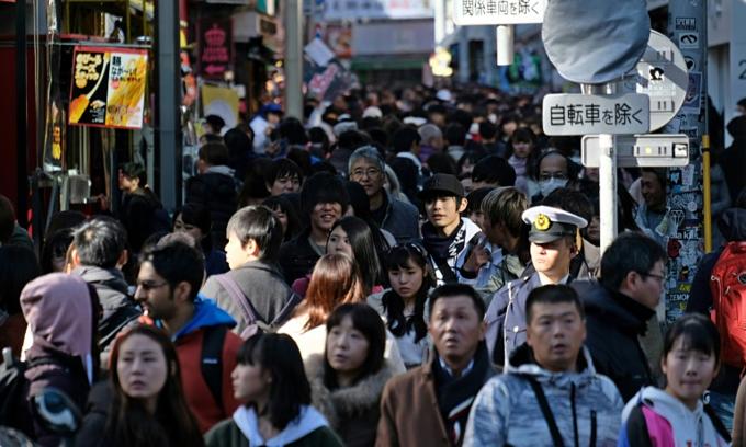 Extra abdication holidays pose dilemma for hardworking Japanese