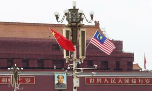 Malaysia, China agree to resume rail project after slashing cost