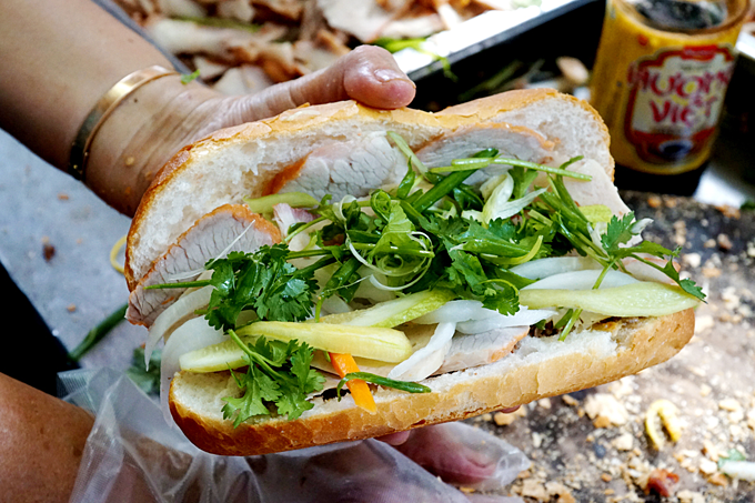 Banh mi is a popular street food which can be found every street corners in Saigon. Photo by VnExpress/Phong Vinh