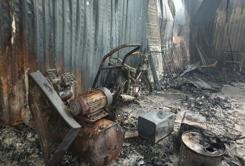 Eight die as blaze guts four workshops in Hanoi