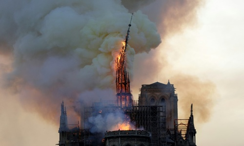 Blaze devastates Notre-Dame, Paris firefighters fear for one bell tower
