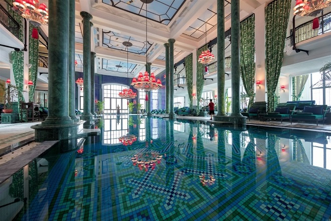 The indoor, heated swimming pool,Le Grand Bassin,boasts spectacular arched columns and an elaborate ceiling composed of marble and mosaic.
