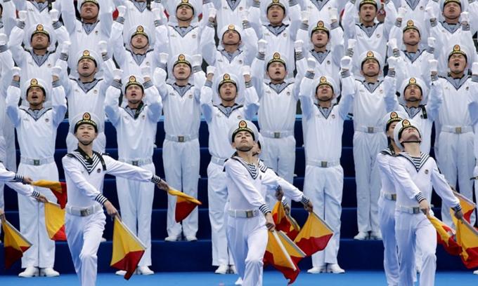 Chinese people love peace, Xi says as kicks off major naval parade