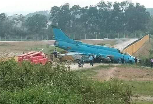 Vietnam military aircraft hits wall on landing as gear fails to deploy